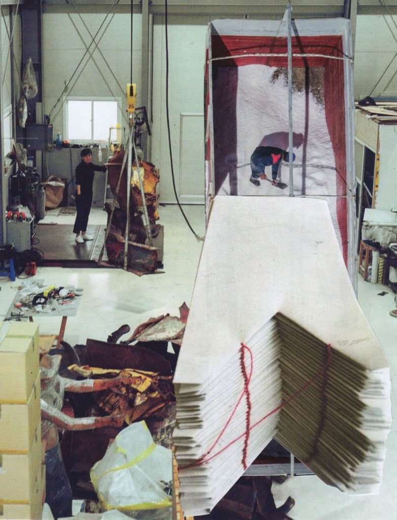 Photo montage in muted colours, construction space with paper sculpture
