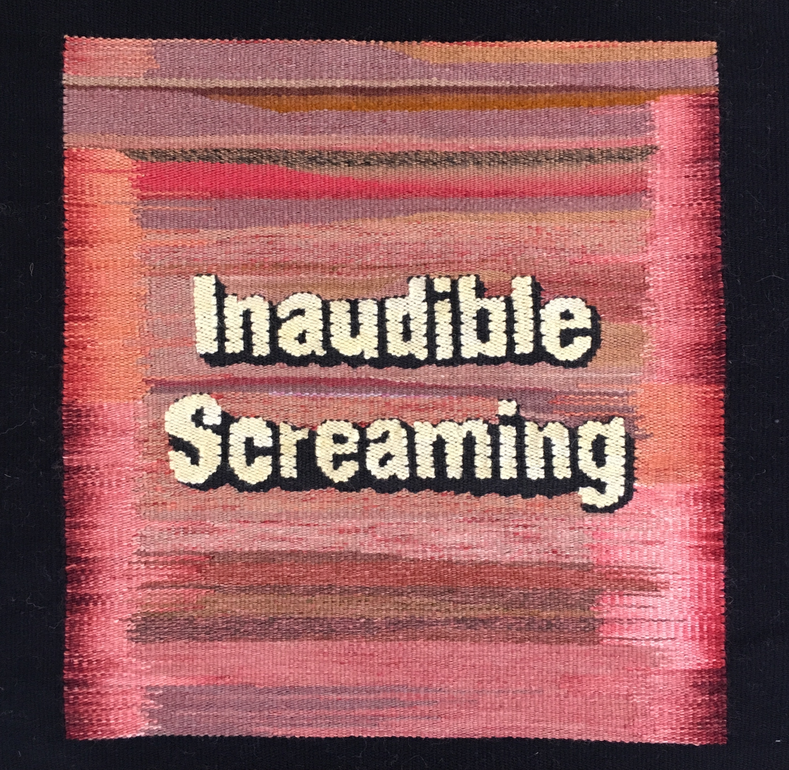 A square tapestry in hues of pink with the words 'Inaudible Screaming' across it